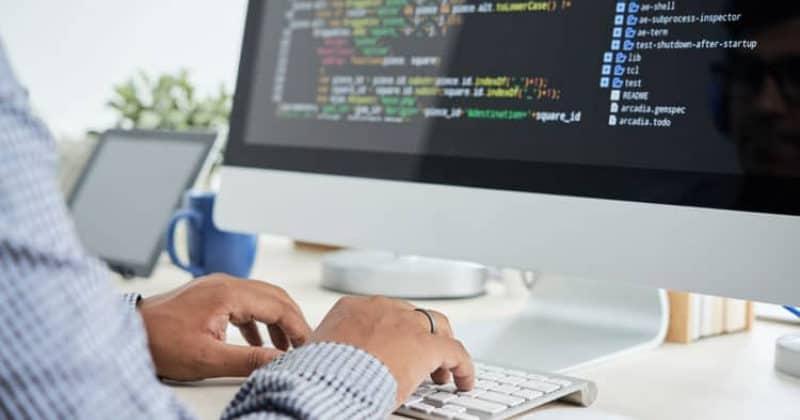 man on computer typing